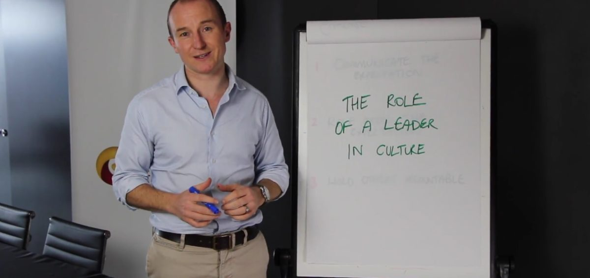 John Colbert giving presentation on The Role of a Leader in Company Culture