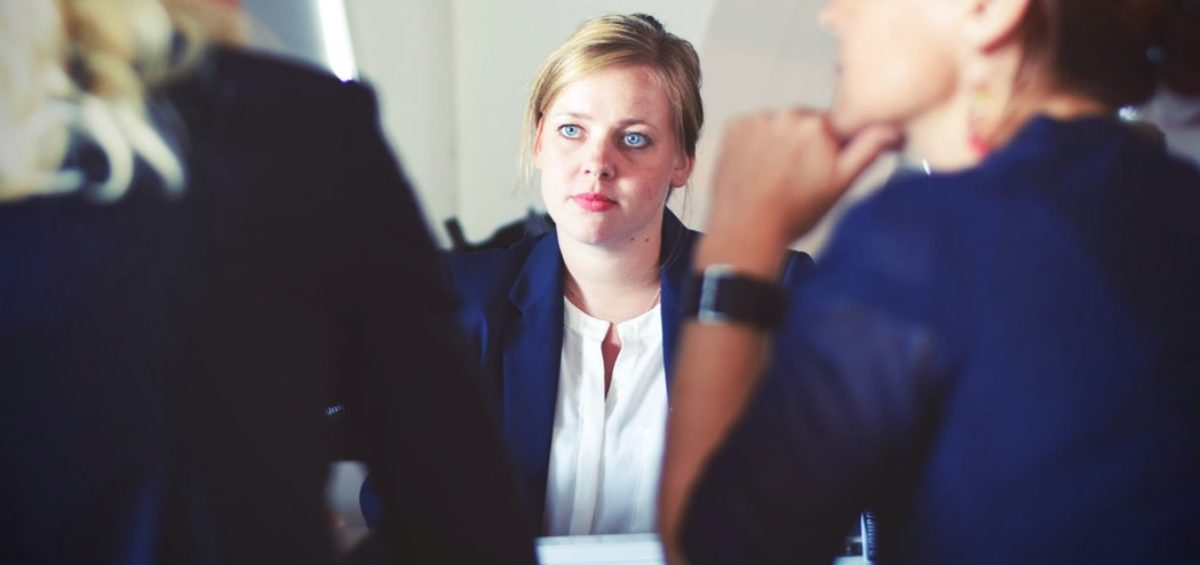 A lady receiving an honest conversation in the workplace