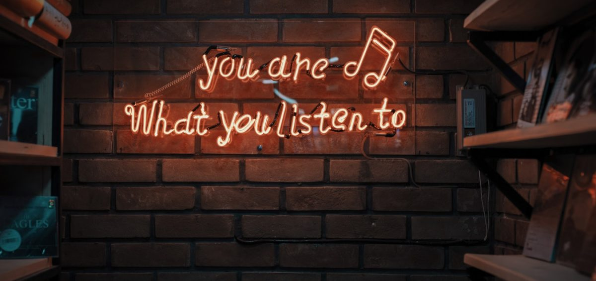"Neon lighting signage with the quote ""You are what you listen to"" - 5 podcasts for leaders"